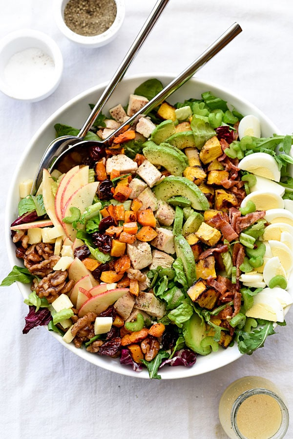 A bowl of Cobb salad on a plate