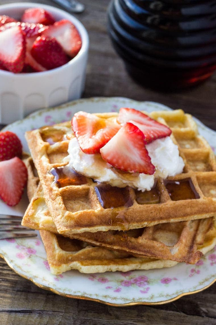 If you're looking for the perfect waffle recipe - look no further! These homemade waffles are perfectly fluffy with soft centers and golden edges. Top with maple syrup and fresh berries for the perfect breakfast!