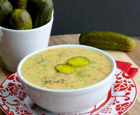 A bowl of soup with pickes