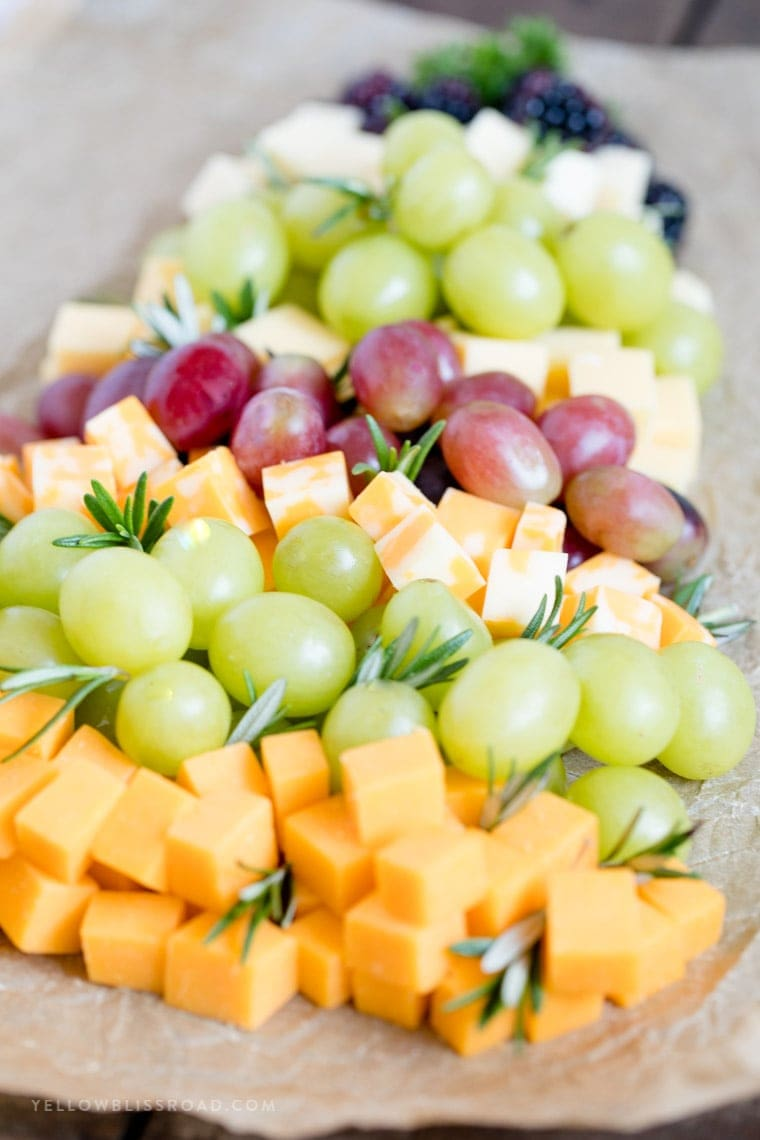 A side angle view of a fruit and cheese platter for christmas