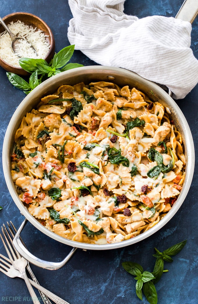 A bowl of pasta with spinach and chicken