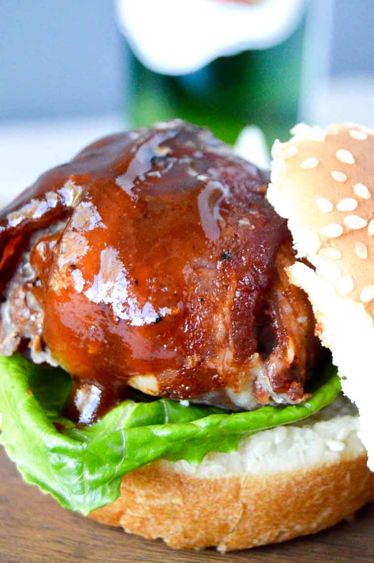 BBQ Bacon Meatball Slider slathered in BBQ sauce on a slider bun