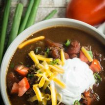Delicious and easy to make healthy turkey chili in a bowl with toppings on top. Great for game day parties.