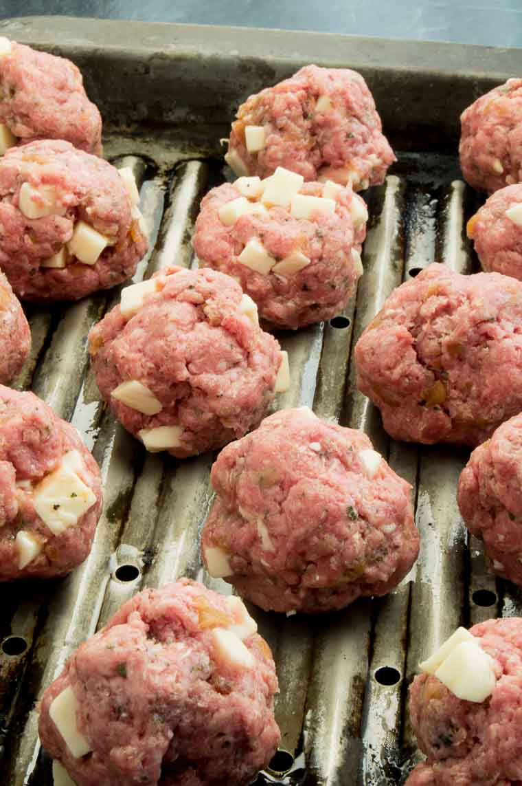 Italian Meatballs on the roasting pan formed evenly, on a roasting pan prior to baking.