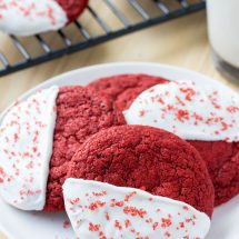 These red velvet cookies are soft, chewy & dipped in white chocolate. Perfect with a glass of milk.