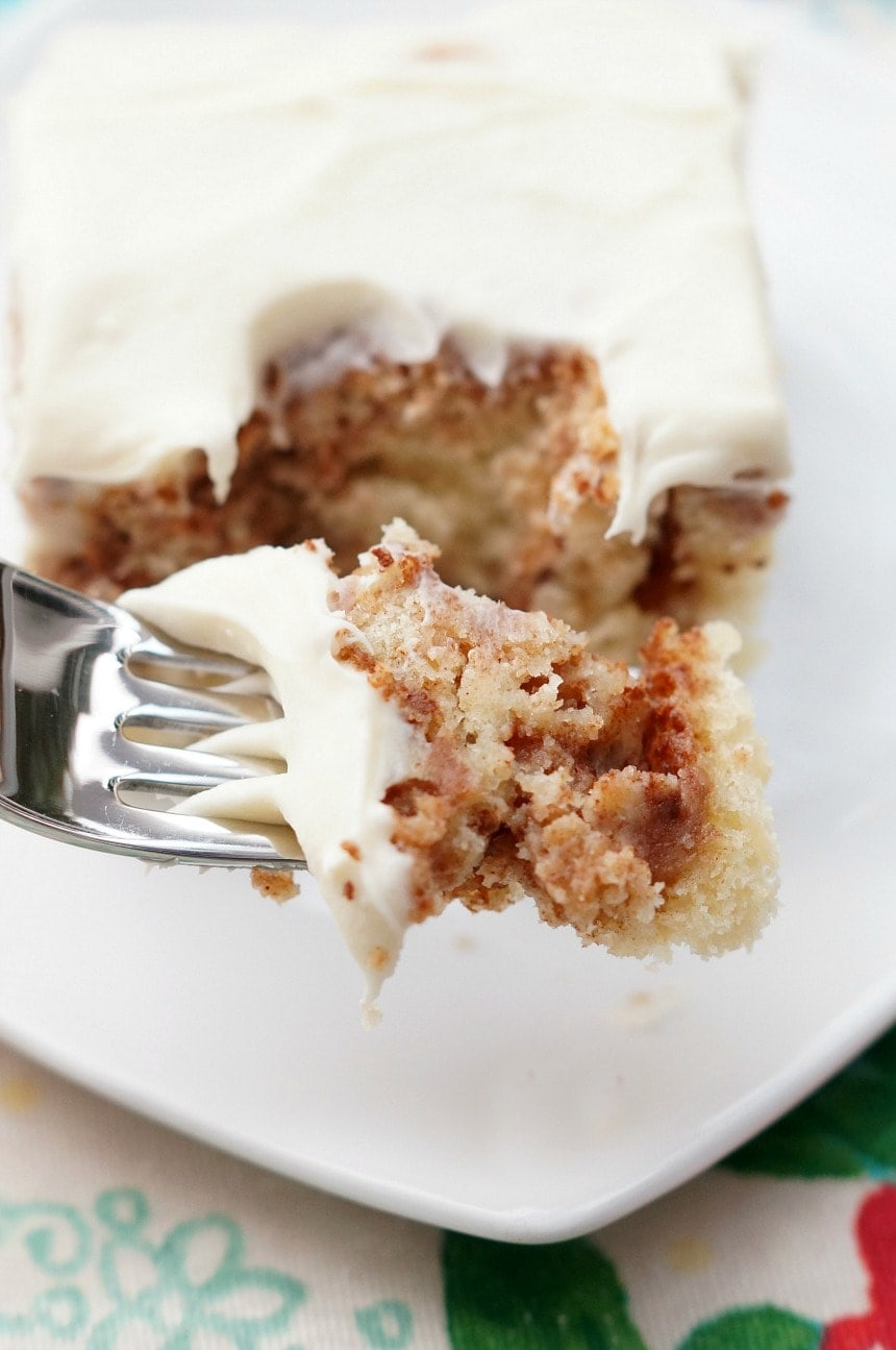 Cinnamon Roll Cake is a fun and easy take on the classic cinnamon roll! A delicious white cake swirled with brown sugar and cinnamon and then topped with cream cheese frosting!