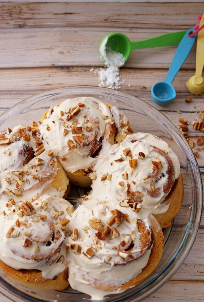 A plate of Cinnamon rolls on a wooden table
