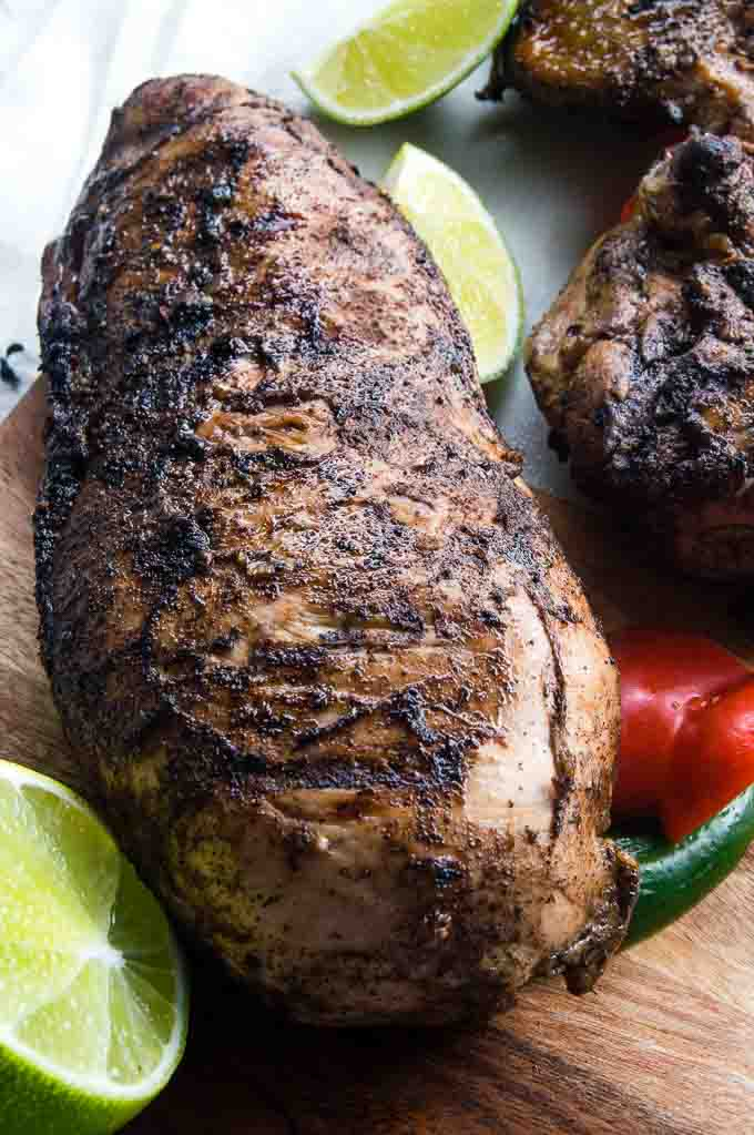 Easy Grilled Jerk Chicken is full of authentic jerk flavor and low on calories for a delicious variation from yourweeknight chicken routine! Your friends & family won't believe how simple this recipe is to make, if you share your secret that is!