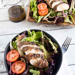 Grilled Jerk Chicken Breast sliced over salad on your picnic table!