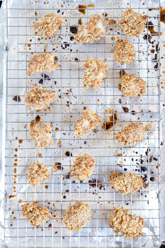 Walnut Crusted Baked Chicken Nuggets spread out on a baking rack over a baking sheet