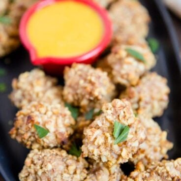 A close up of walnut crusted chicken nuggets