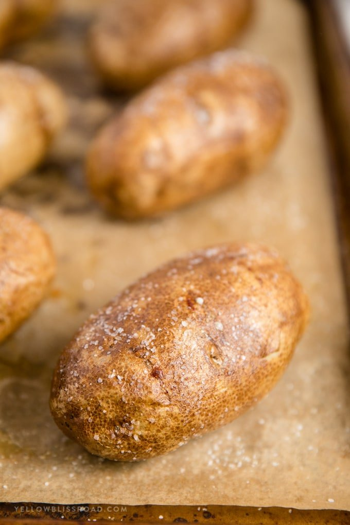 baked potatoes on a baking sheet lined with parchment paper