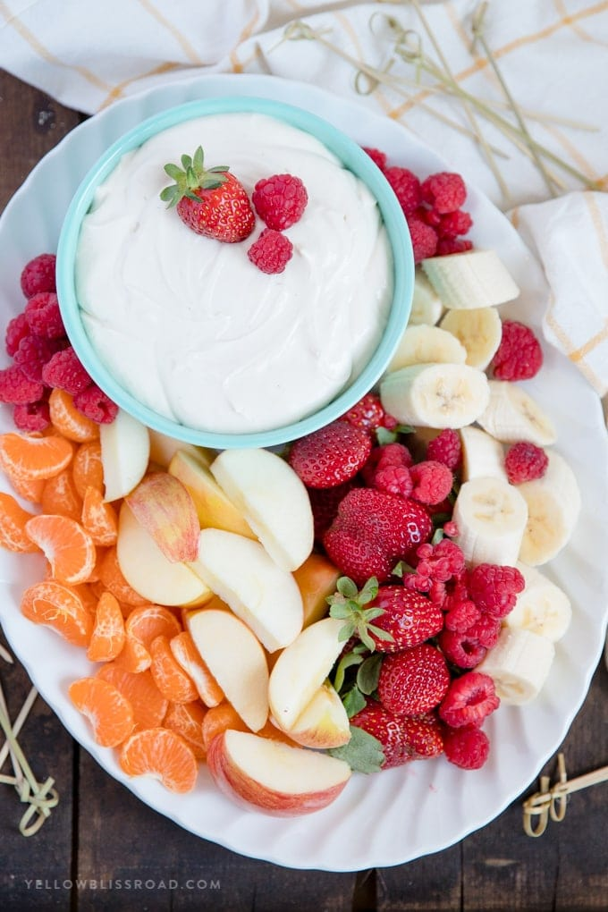 Platter of fresh fruit with a bowl of easy, 3 Ingredient Cream Cheese Fruit Dip