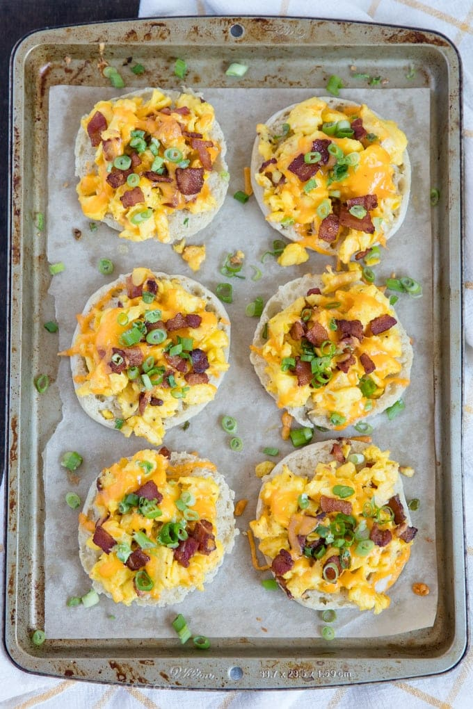 A tray of English muffin breakfast pizzas