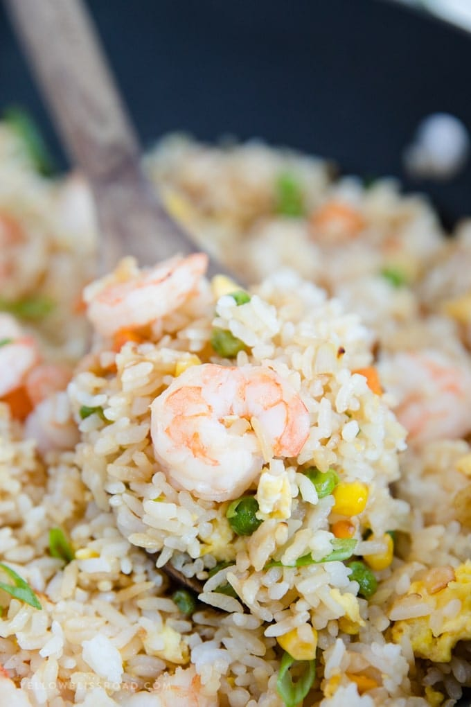 Close up of shrimp fried rice on a wooden spoon