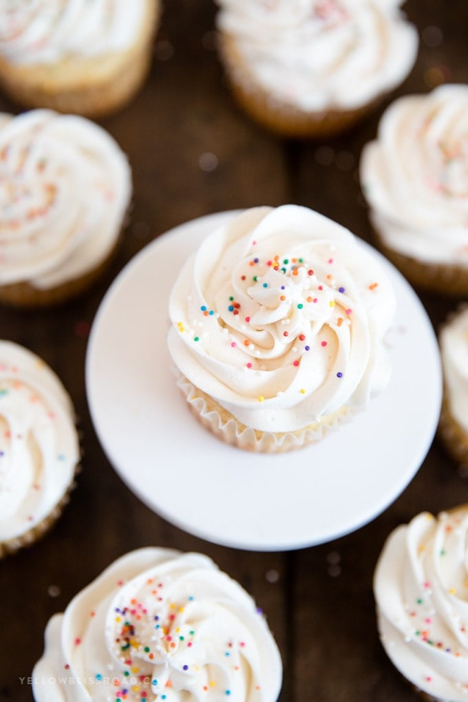 overhead shot of cupcakes with white frosting and sprinlkes