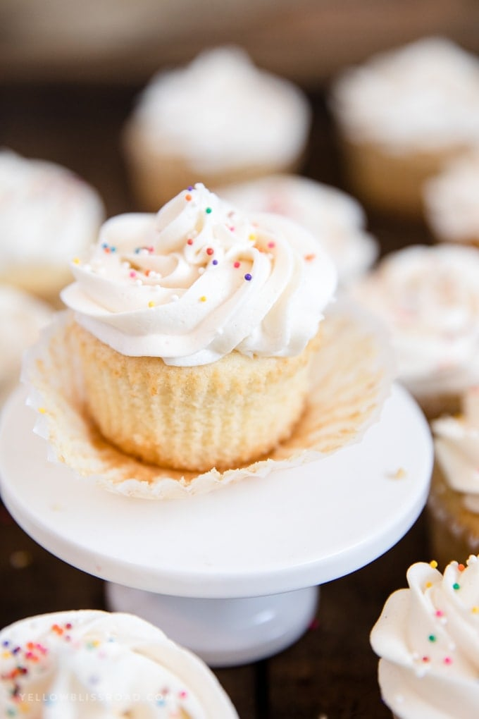 A close up of a Cupcake with vanilla frosting