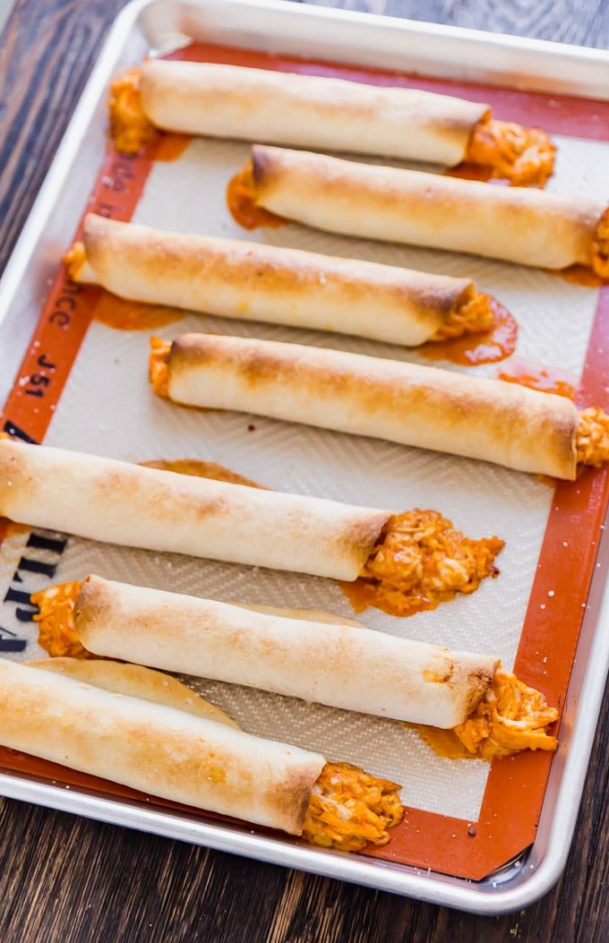 If Buffalo Chicken Dip and Chicken Taquitos had a baby, this would be it! And what a beautiful baby she is, with spicy shredded buffalo chicken wrapped in flour tortillas and baked to perfection- this is one snack that will be everyone's favorite!