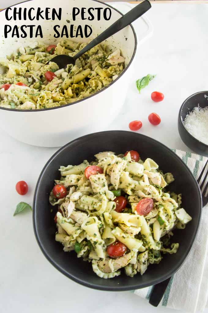 A bowl of food on a plate, with Pesto and Pasta