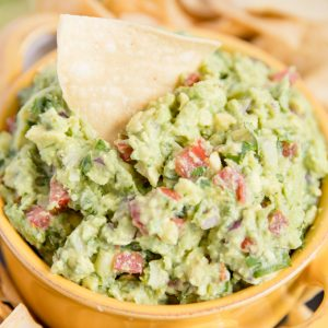 A close up of a yellow bowl of Guacamole