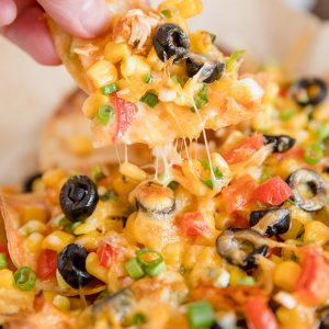 A close up of loaded chicken nachos