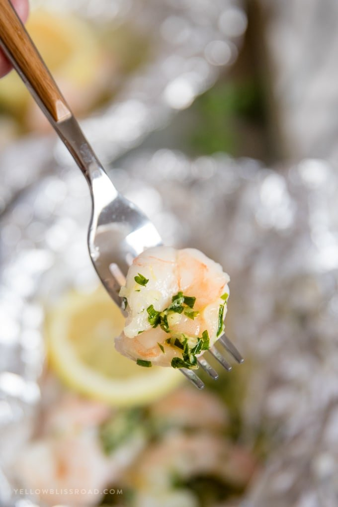 a foil packet shrimp on a fork