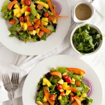overhead photo of two black bean and mango salads