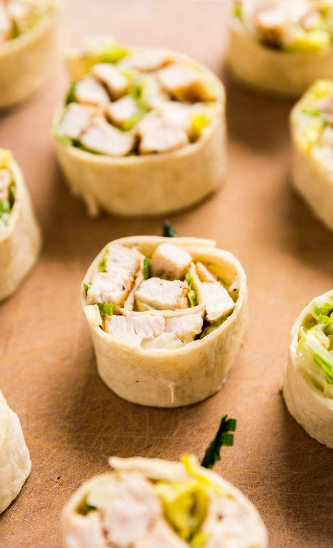 Chicken Caesar Salad Pinwheels make a light and delicious lunch or and super tasty appetizer! They're also an excellent way to use leftover chicken!