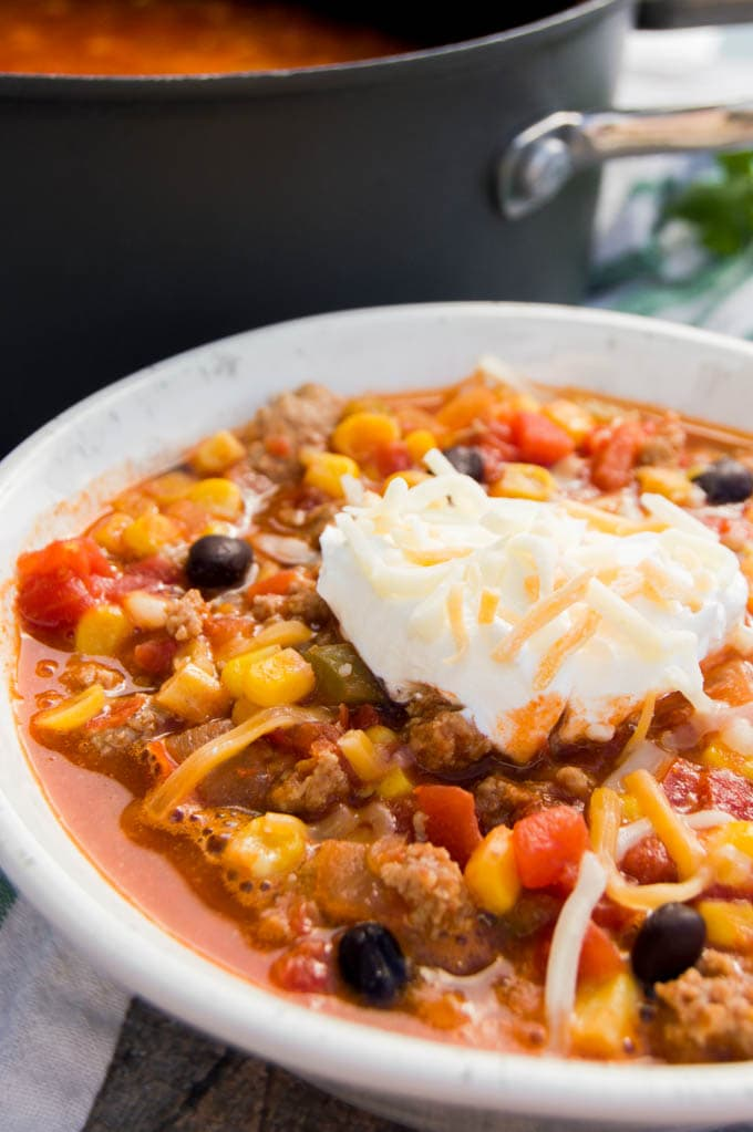 Turkey Taco Soup in a bowl topped with sour cream