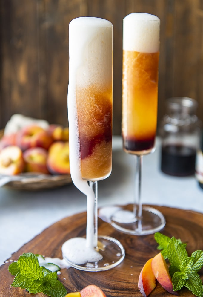 frozen peach bellini with champagne bubbles spilling over