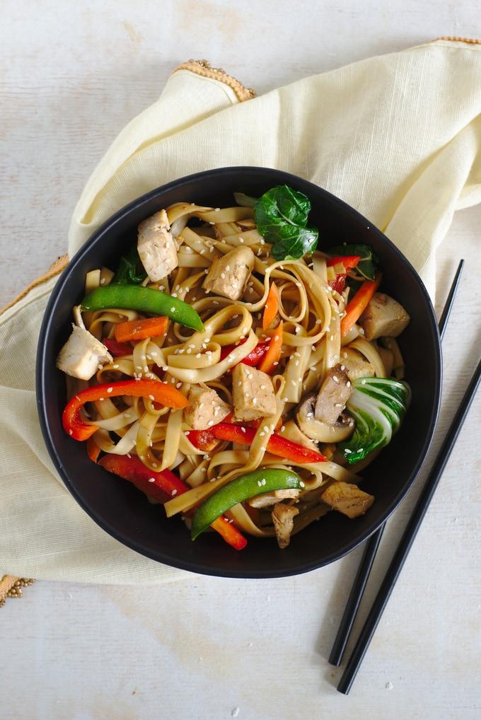 ChickenLo Mein in a bowl with chop sticks