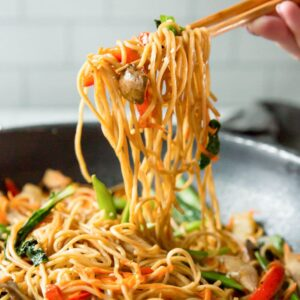 A pan filled with chicken lo mein