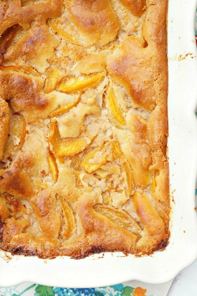 easy peach cobbler in baking dish, just out of the oven