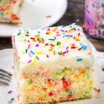 A slice of funfetti sheet cake with vanilla frosting makes for the perfect birthday cake recipe.