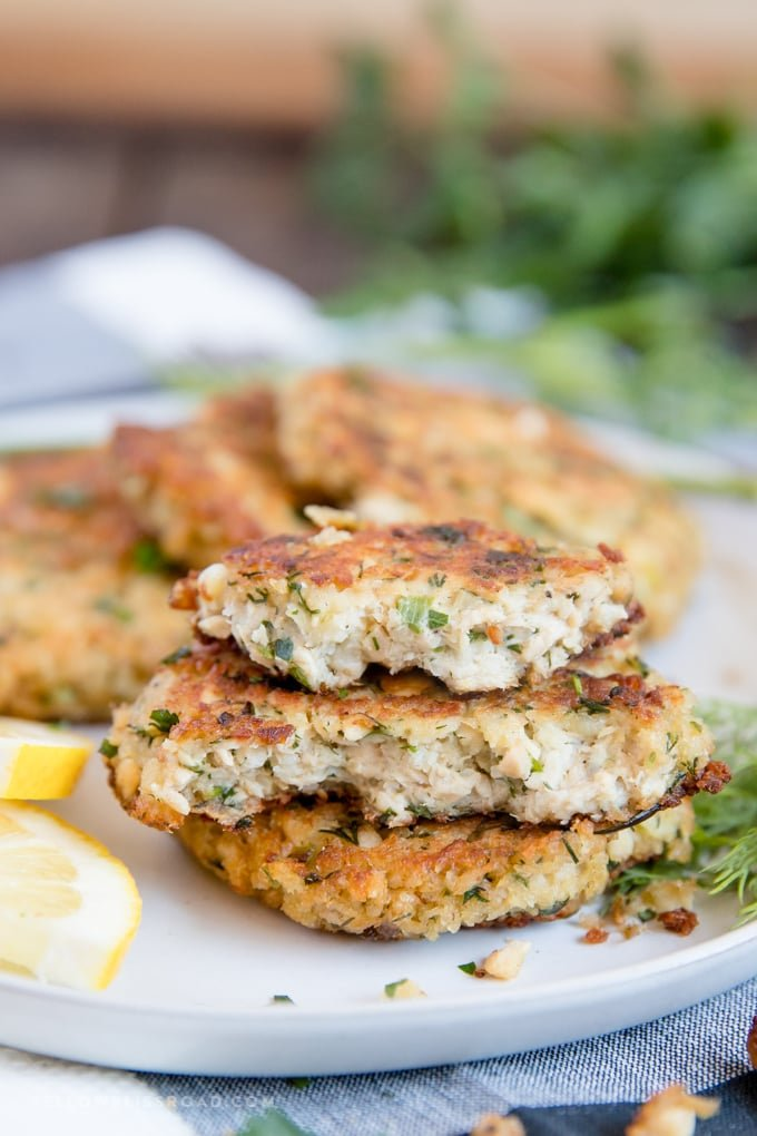 salmon patties broken in half to show the tender insidess | salmon patty recipe | salmon cakes