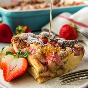 a square image of strawberry baked french toast for social media