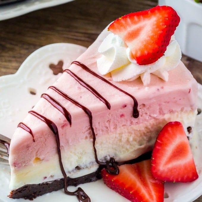 A close up of a slice of Strawberry Ice Cream Cake