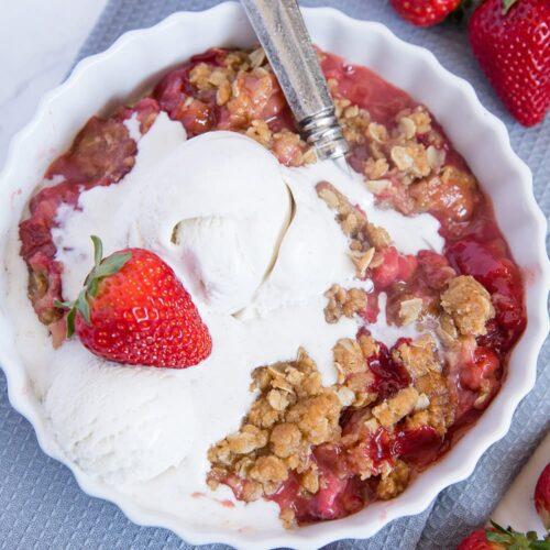 A dish of Strawberry Rhubarb Crisp with ice cream