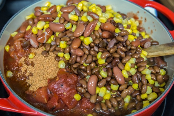 a pot full of black beans, kidney beans, corn, tomatoes and ground turkey