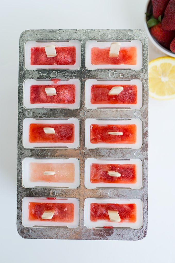 popsicle mold filled with strawberry lemonade popsicle mix