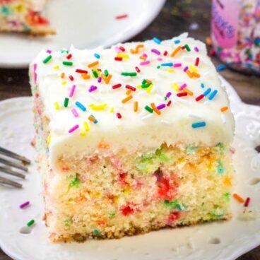 A piece of funfetti cake on a plate