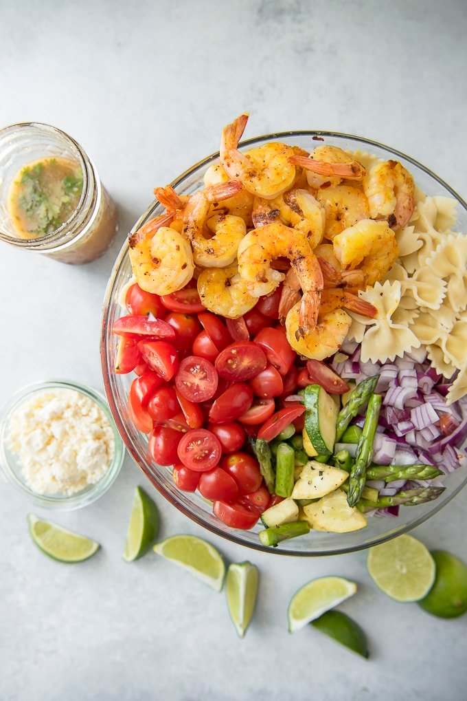 ingredients for Grilled Shrimp Pasta Salad in a serving bowl