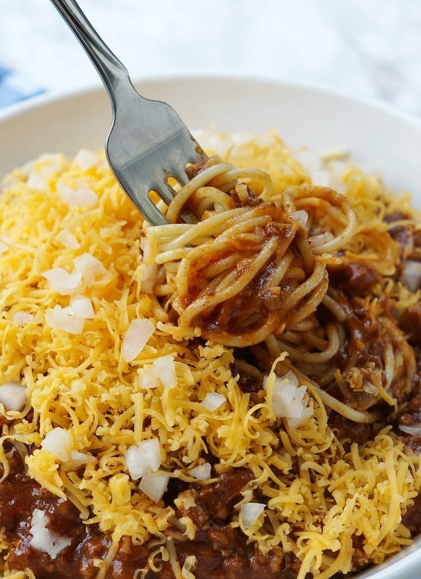 a fork picking up a bite of instant pot skyline chili