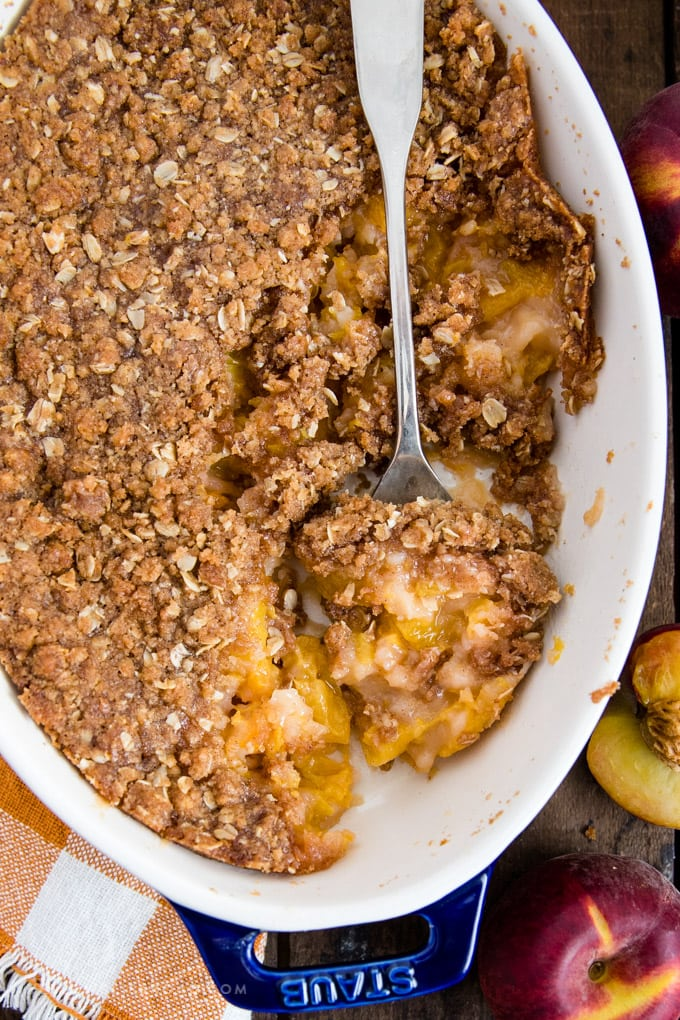 A baking dish with fresh peach crisp