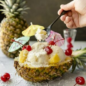 A half pineapple filled with ice cream