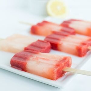 A close up of strawberry popsicles