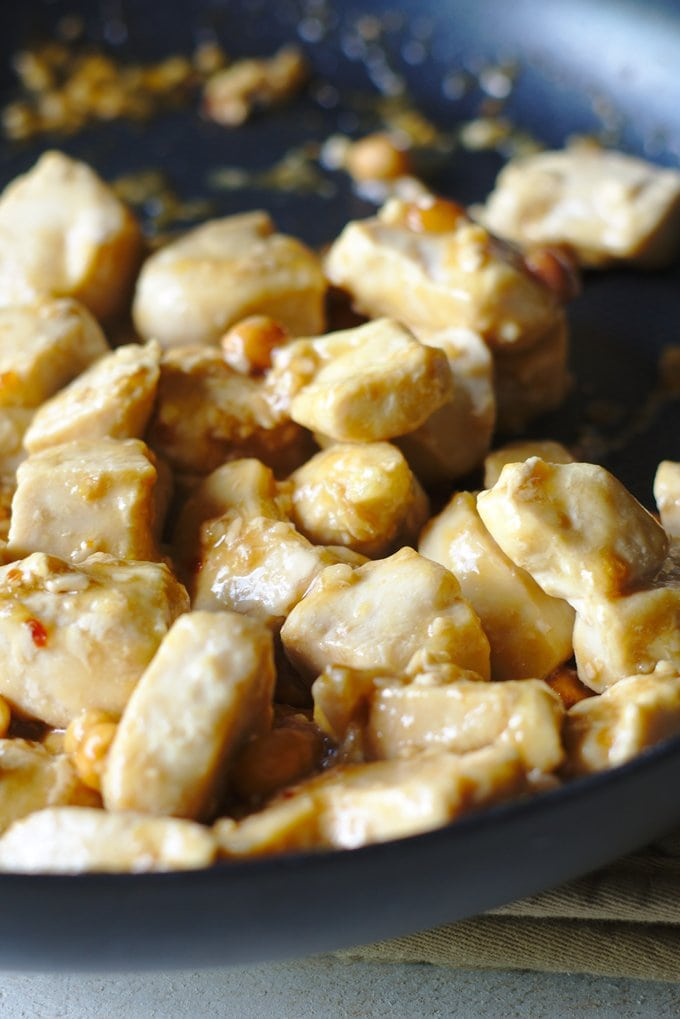 Kung Pao Chicken cooking in a skillet