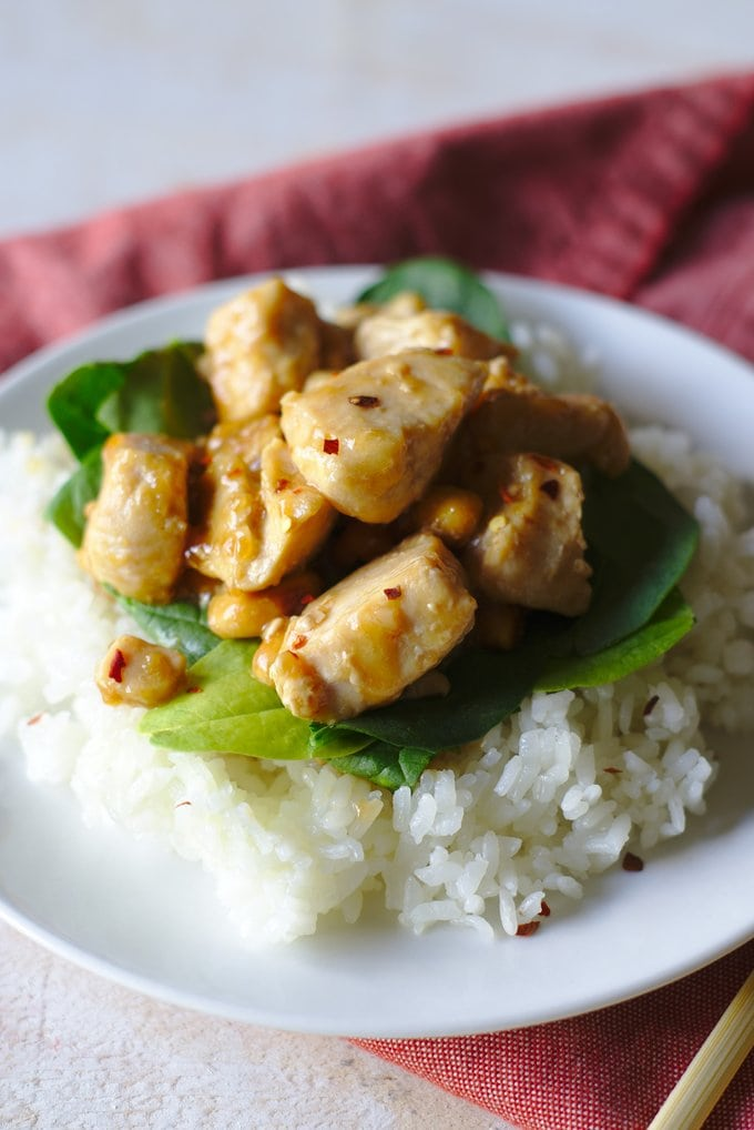 Kung Pao Chicken served over spinach and rice