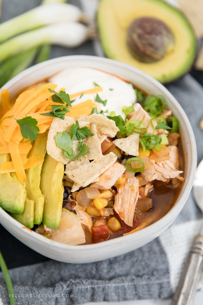 Chicken tortilla soup with crushed tortillas.