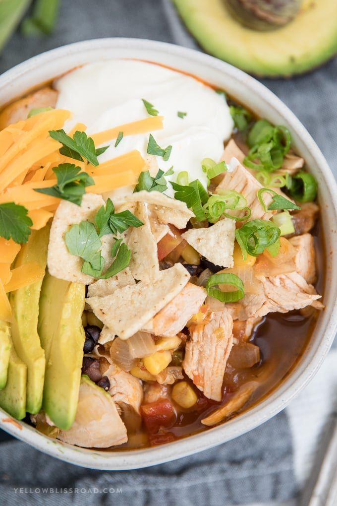 close up image of a bowl of chicken tortilla soup